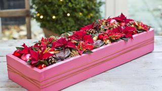 Centre de table de Noël avec boîte recyclée