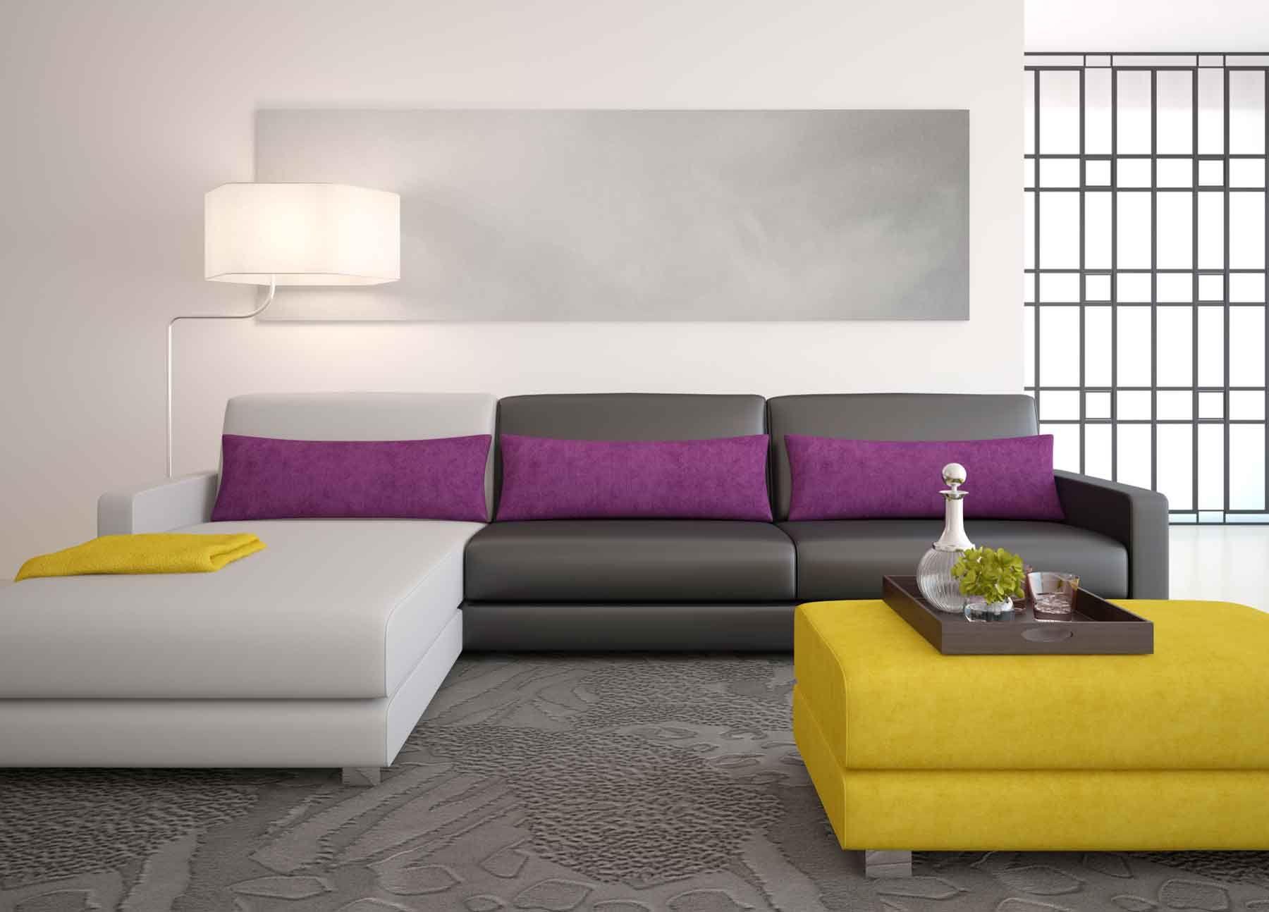 Combinez différentes nuances de gris sur le canapé